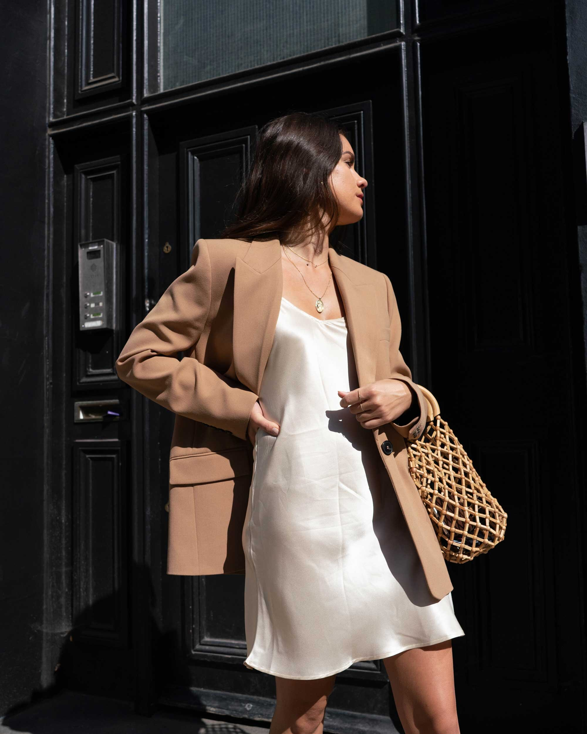 Sarah Butler of Sarah Styles Seattle wears ivory Slip dress and tan blazer in London | @sarahchristine -1.jpg