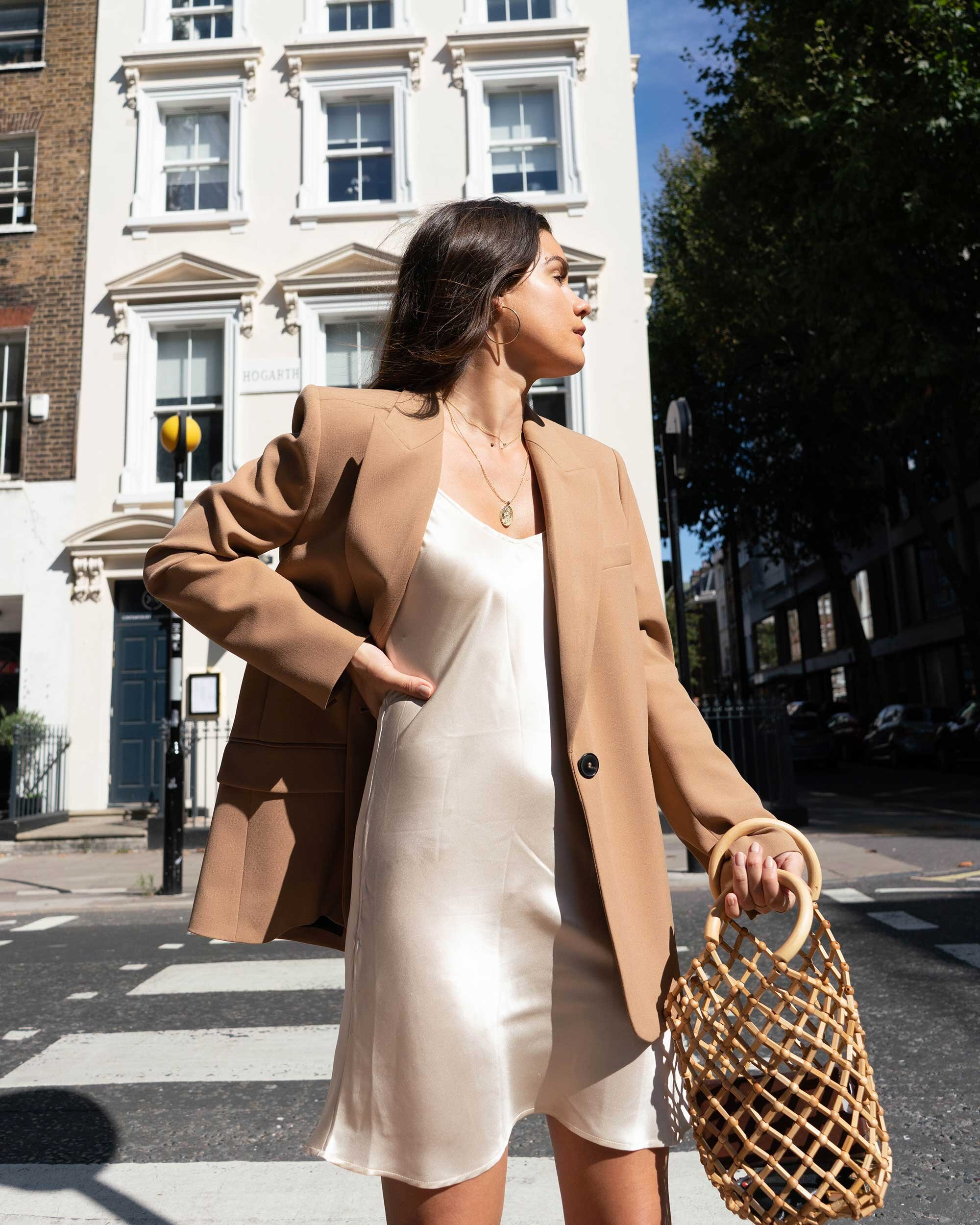 Sarah Butler of Sarah Styles Seattle wears ivory Slip dress and tan blazer in London | @sarahchristine -9.jpg