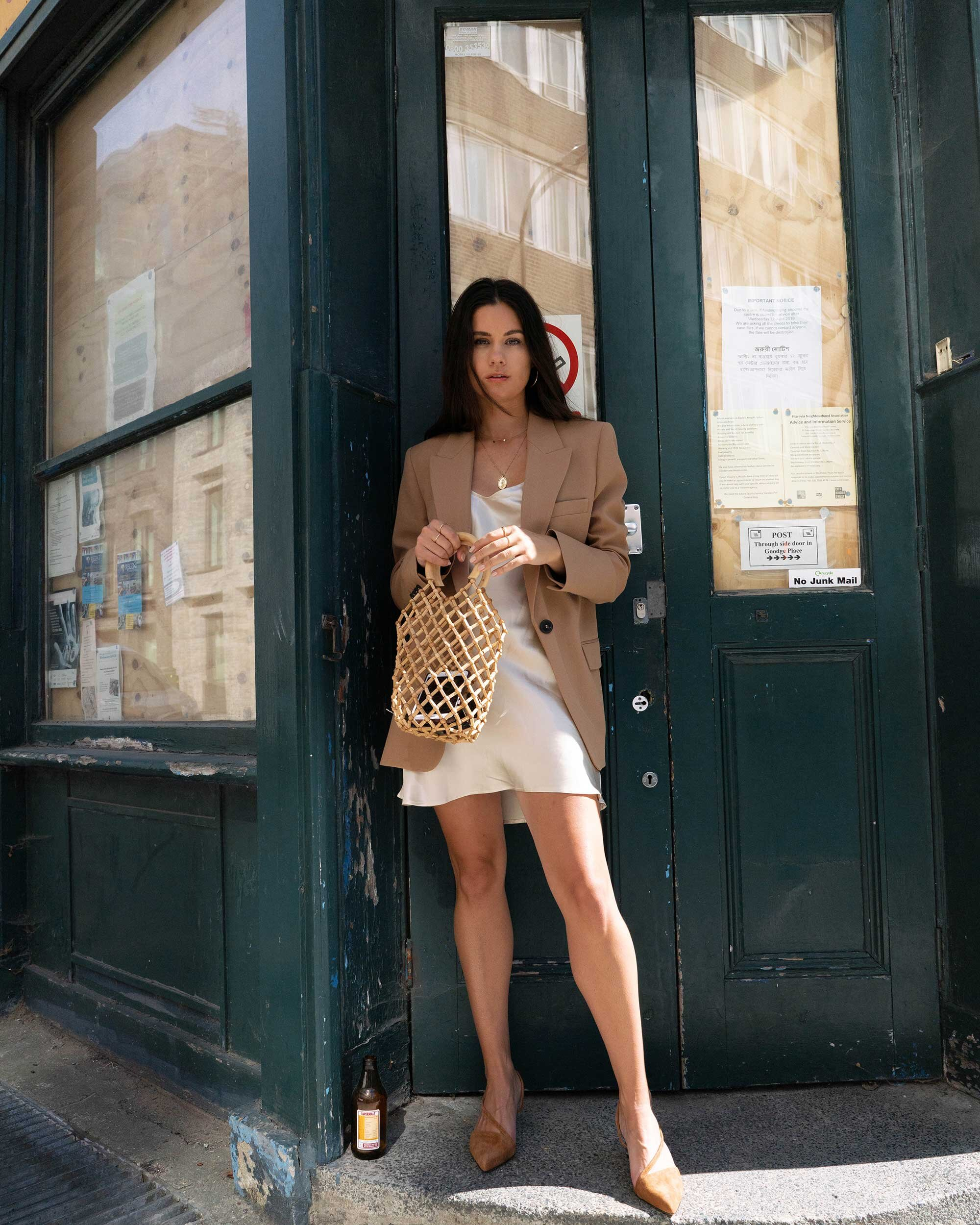 Sarah Butler of Sarah Styles Seattle wears ivory Slip dress and tan blazer in London | @sarahchristine -10.jpg