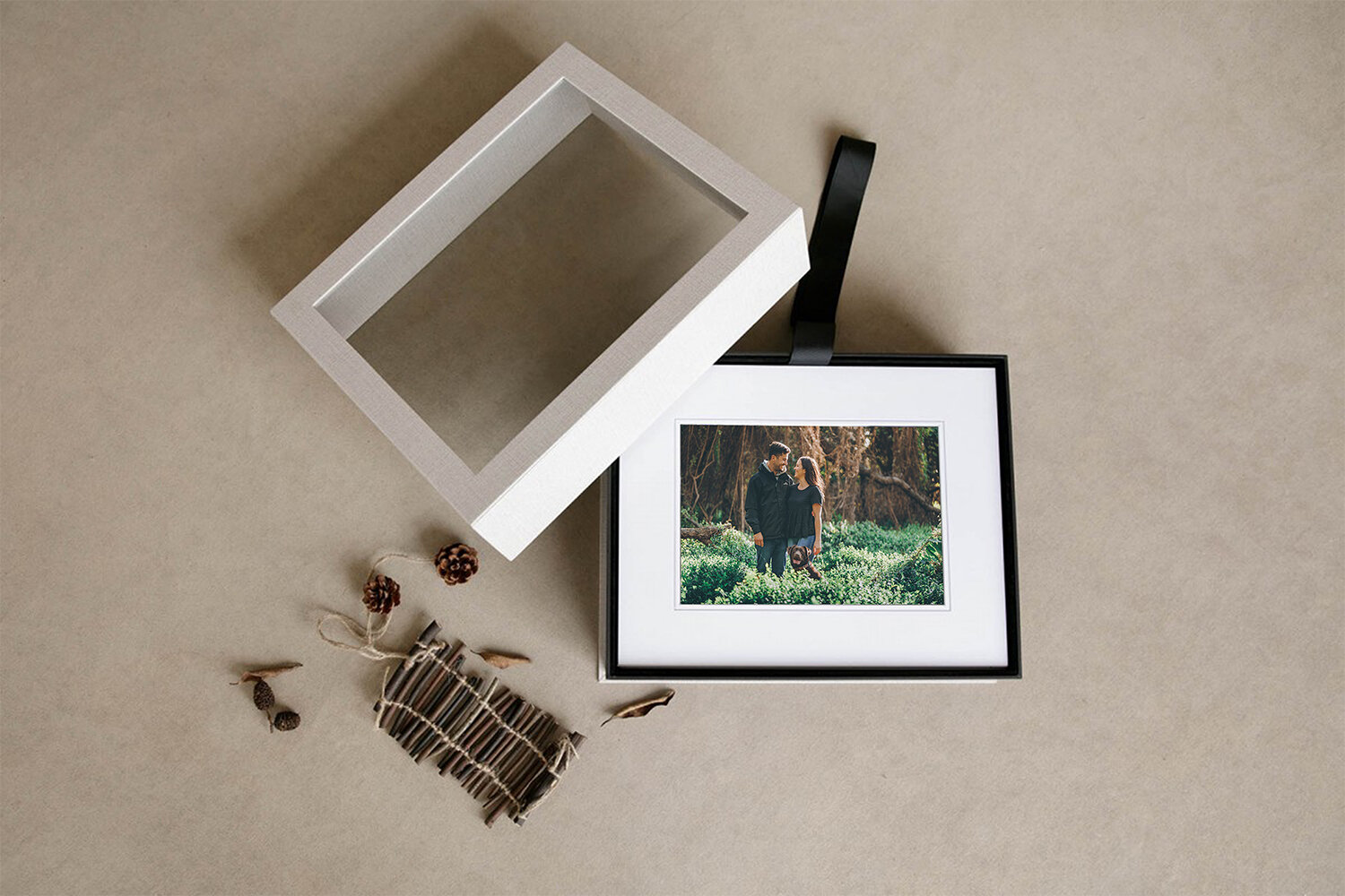 Signature box - Individual fine art prints size 5x7.5 mounted and matted to 8x10. Overall size is ready for an 8x10 frame. Our Signature Box has a large crystal clear window on the lift-off lid of the box that reveals the image below the glass. It is fully lined with black velvet and features a lift-out black ribbon.Available in our Fine Art Print + Digital Collections of 20 or all session images.From $1430