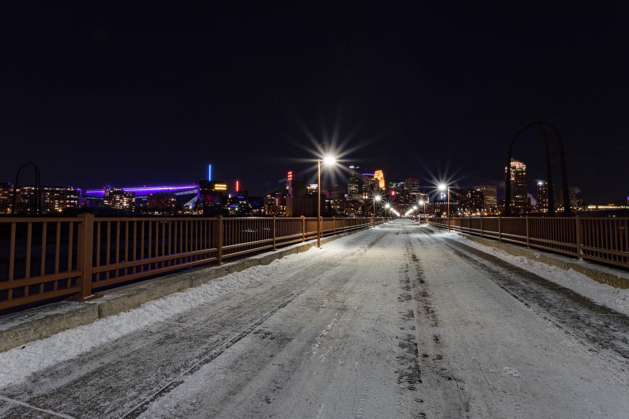 snowed arch bridge - minneapolis