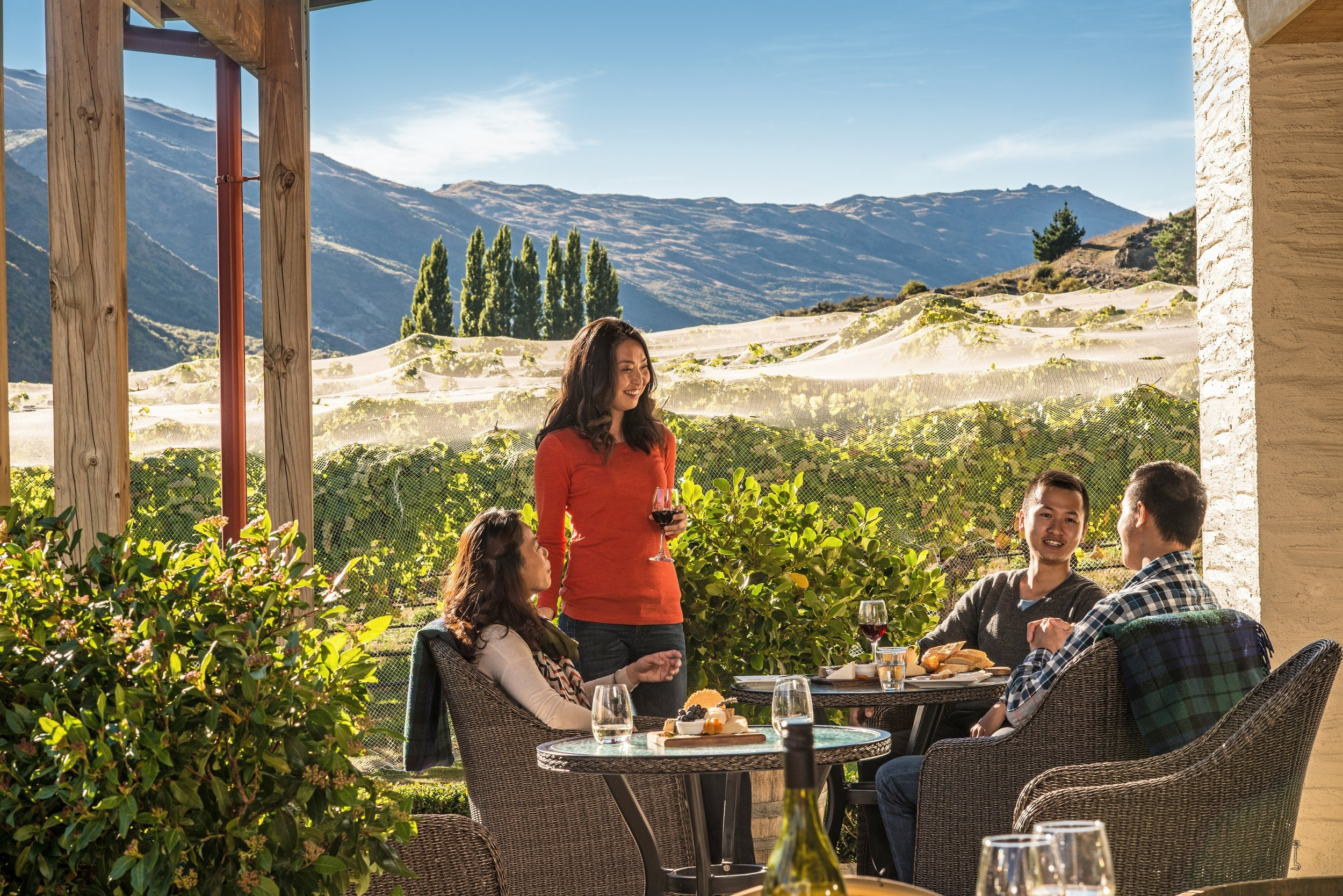 Friends enjoying wine and cheese at Gibbston Valley.jpg