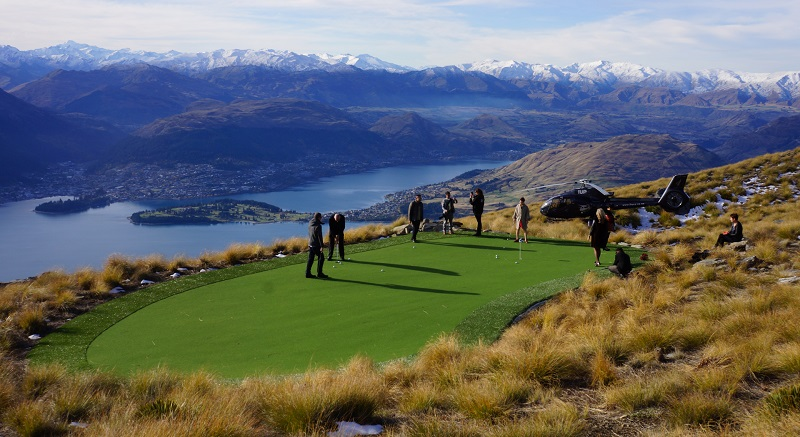 Over The Top - The World's Most Spectacular Par 3 Heligolf Experience. Fly to 4500 feet, tee off & attempt a hole in one. Marvel at the views while sipping on a glass of champagne!(Complimentary to you with this Majestic Queenstown Tour)