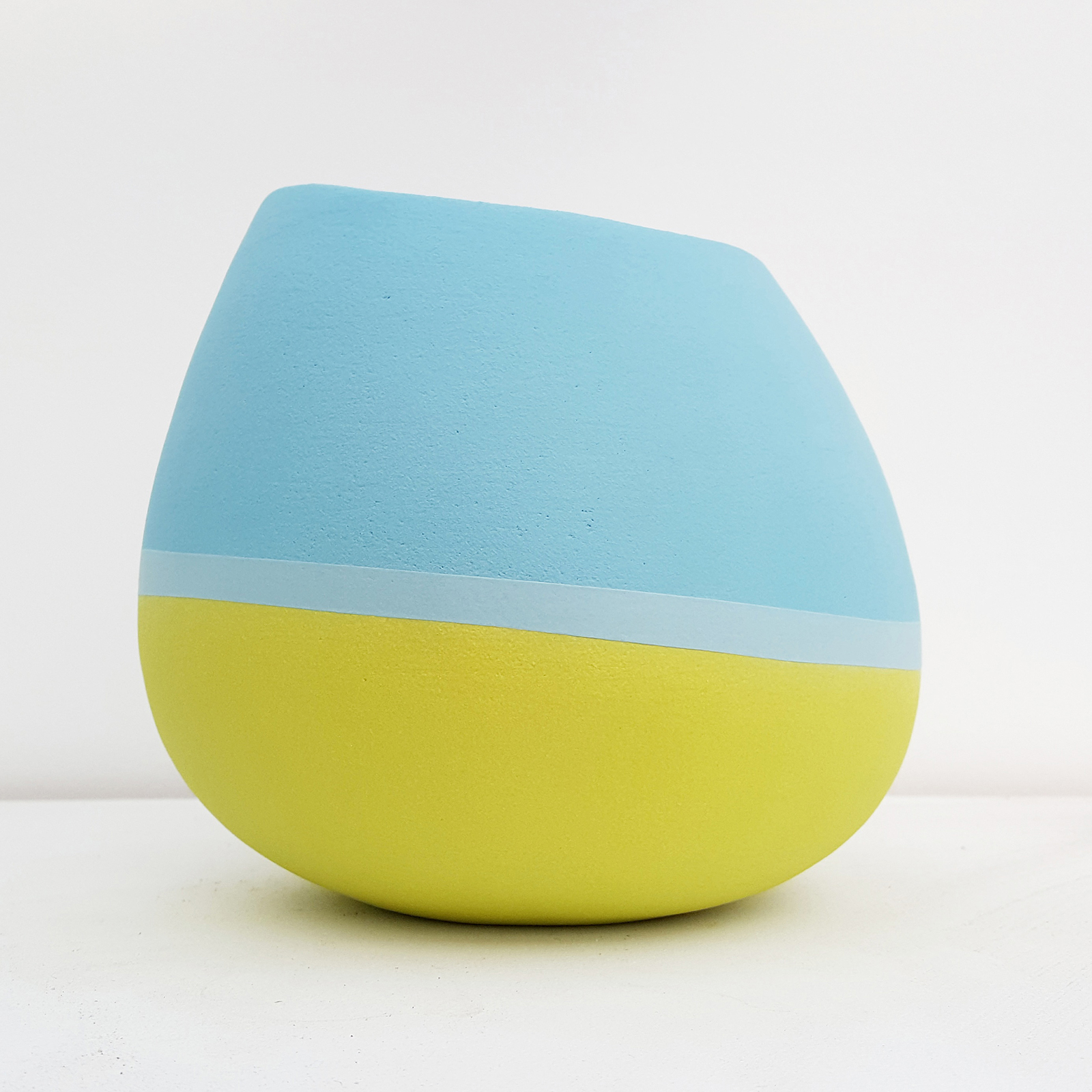 Open vessel form - bright blue, pale blue and lime green - height approx 18cm