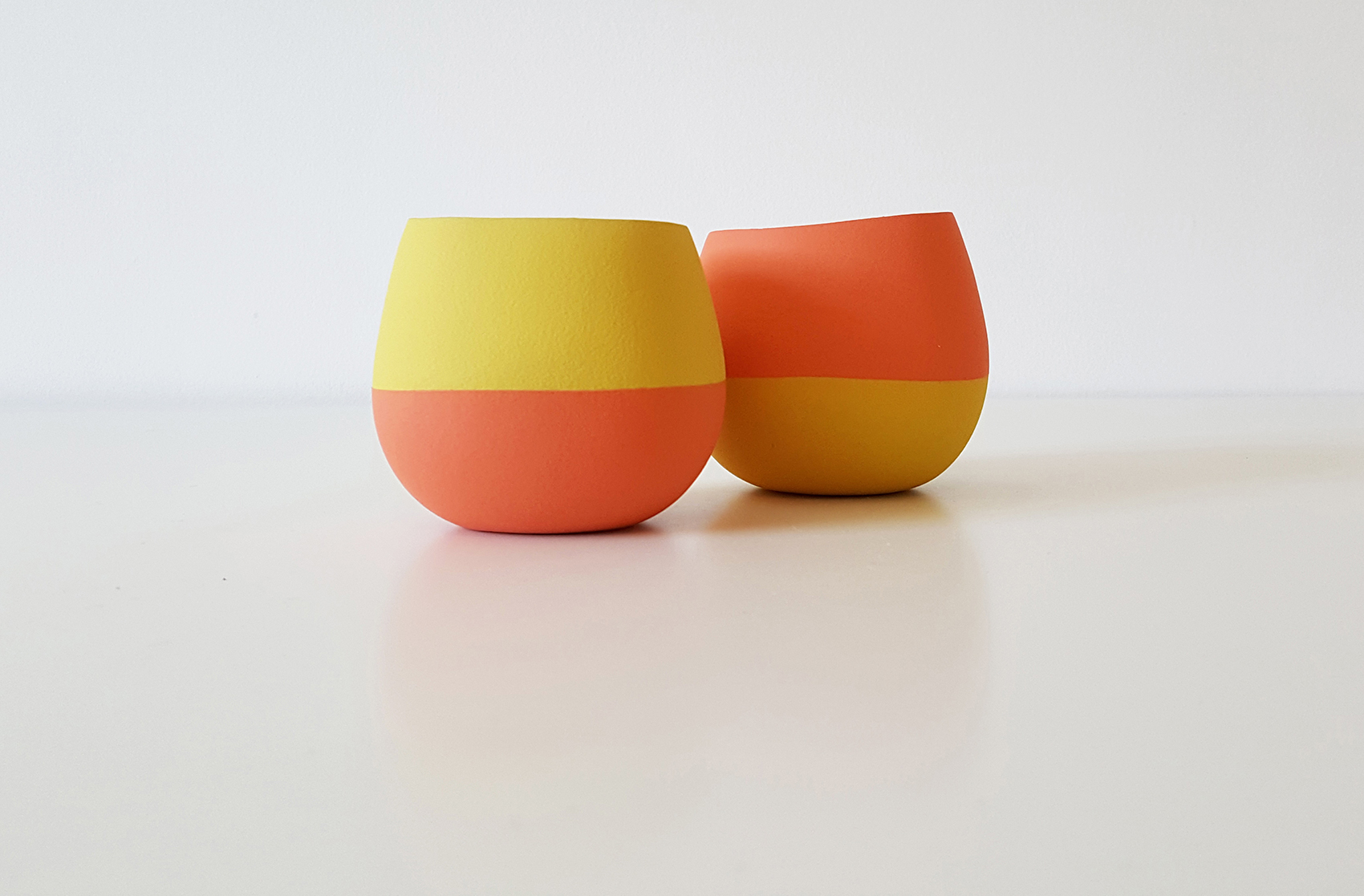Small open vessel forms - orange, yellow and yellow, orange - height approx 8cm
