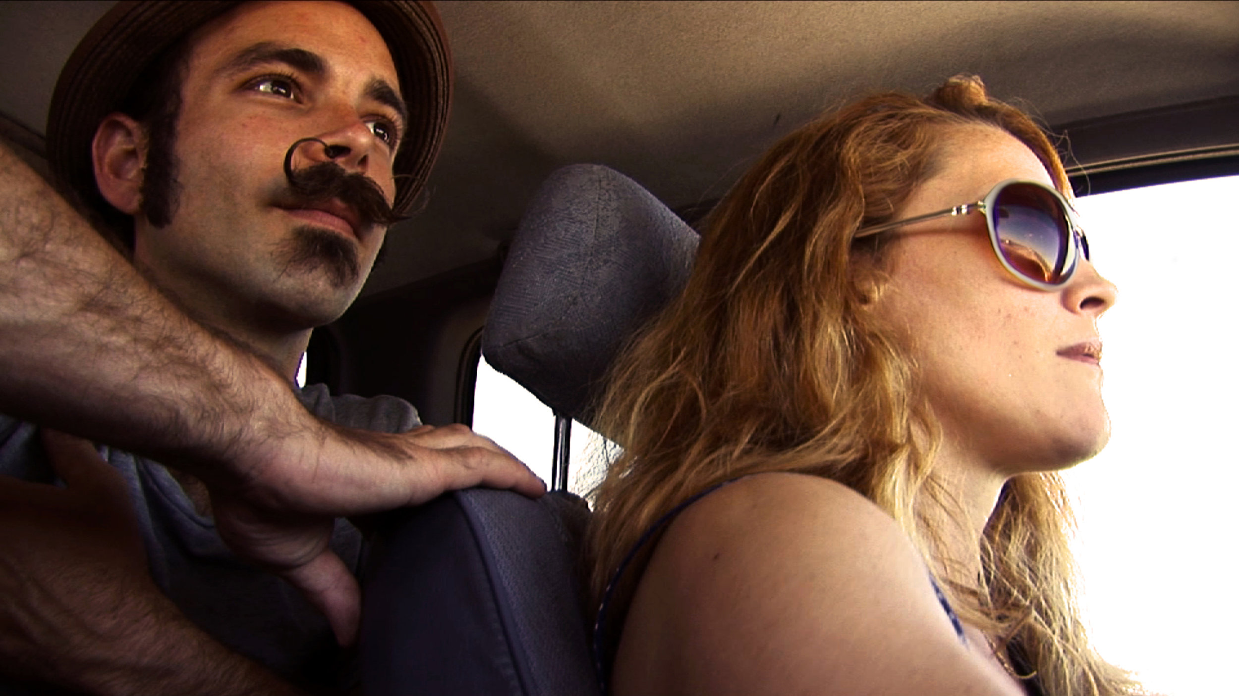 Trixie & Monkey driving home to Baltimore after a Southern tour, 2012, Film Still by Kirsten D'Andrea Hollander