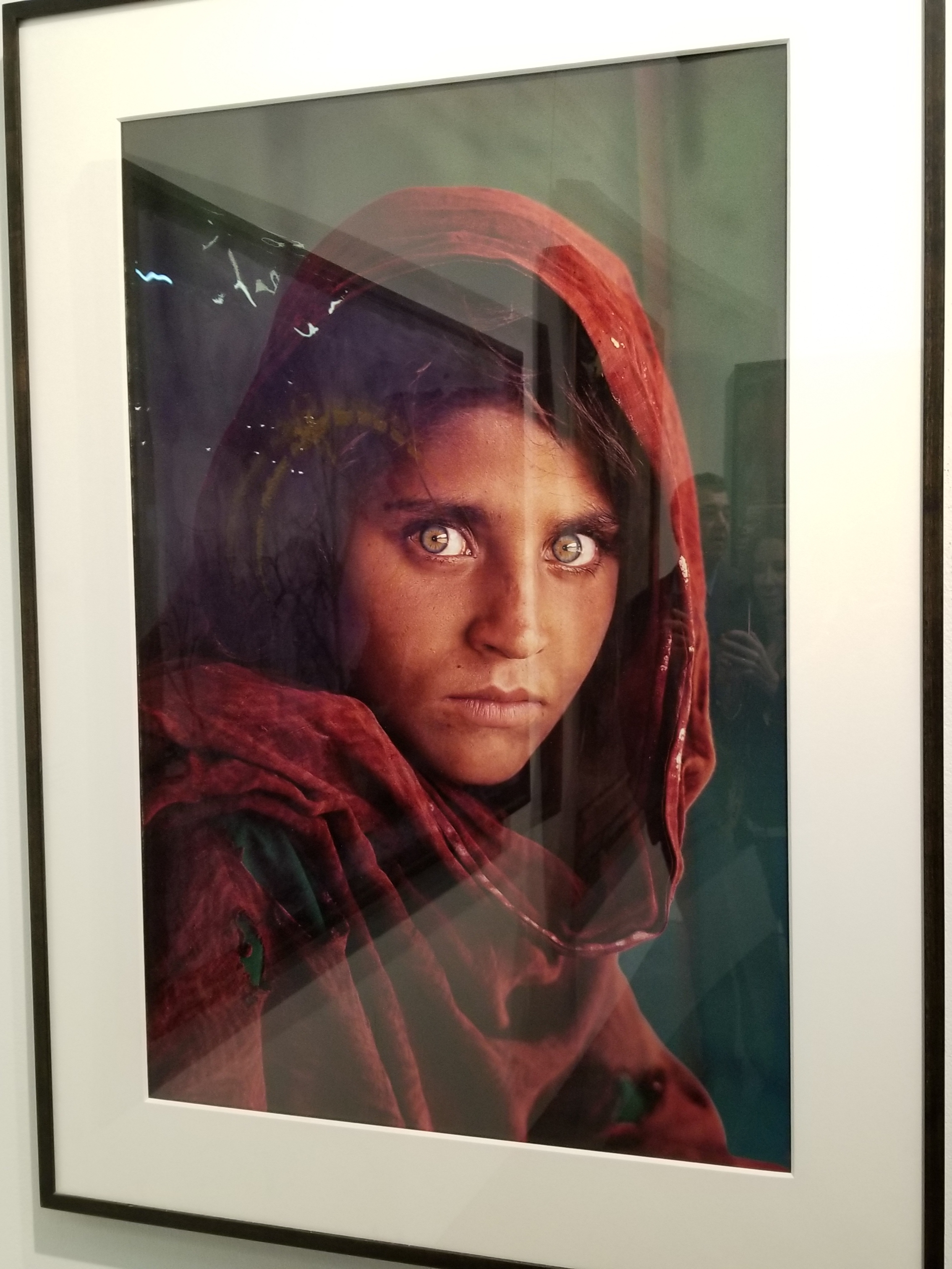 """Afghan Girl"" photographed by Steve McCurry on display at Art New York"
