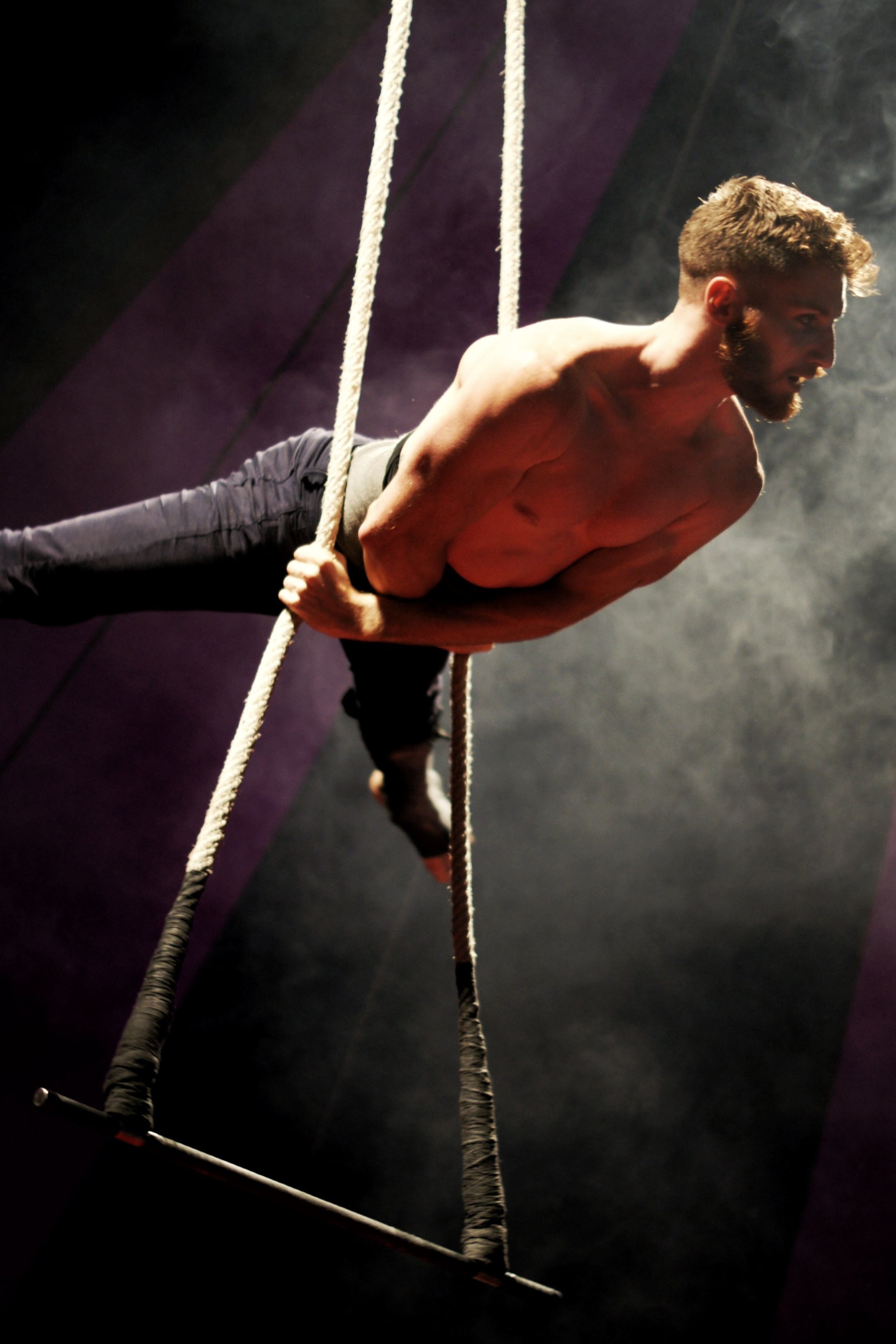 Kevin Beverley on Trapeze at Midnight Circus