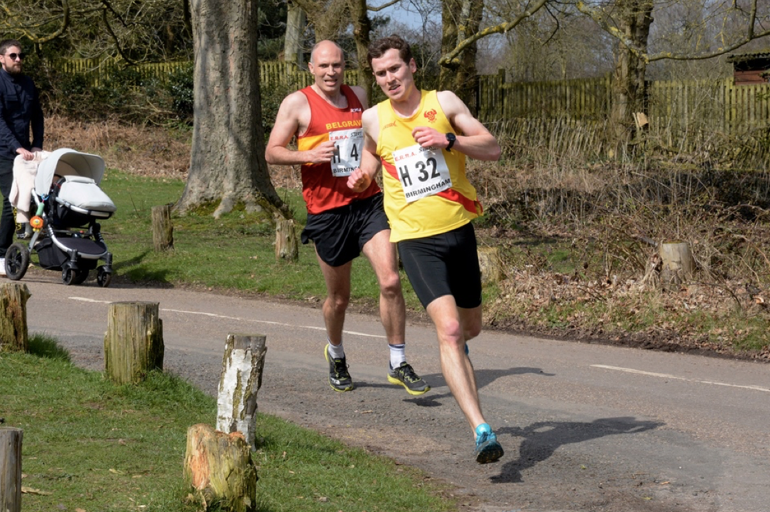 Andrew Penney eases ahead of Belgrave's Will Cockerell to clock the team's fastest short leg time at the 12-stage National Road Relay Championships at Sutton Park, Birmingham