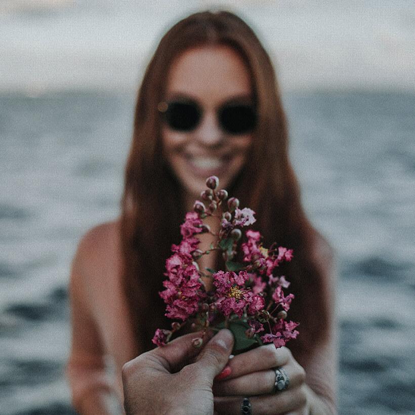 woman-holding-flower-square (1).jpg