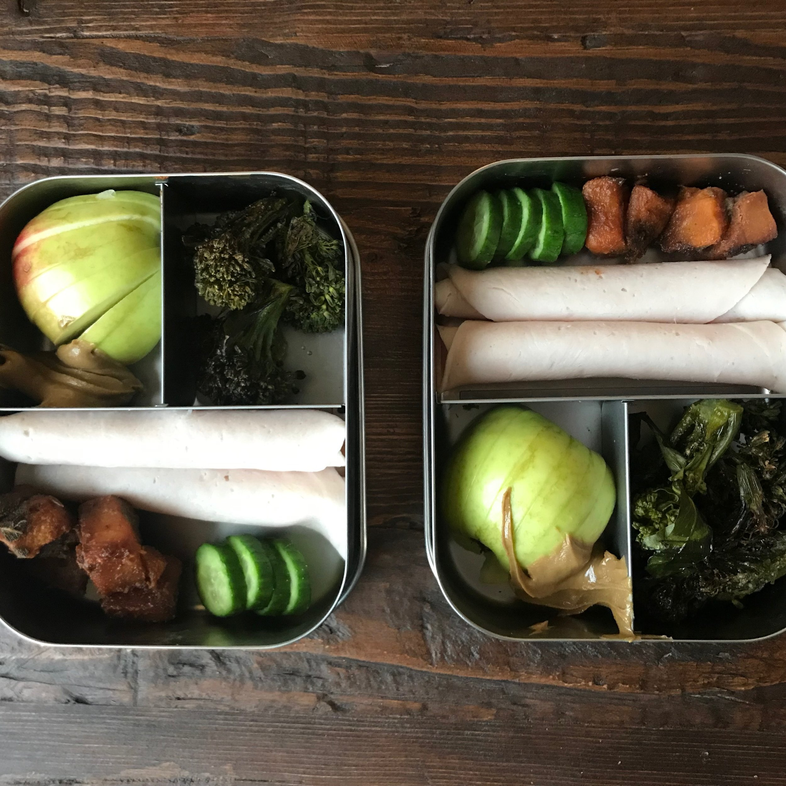 Main: Turkey, cucumbers, butternut squash  First small section: Apple and sunflower butter  Second small section: broccoli heads