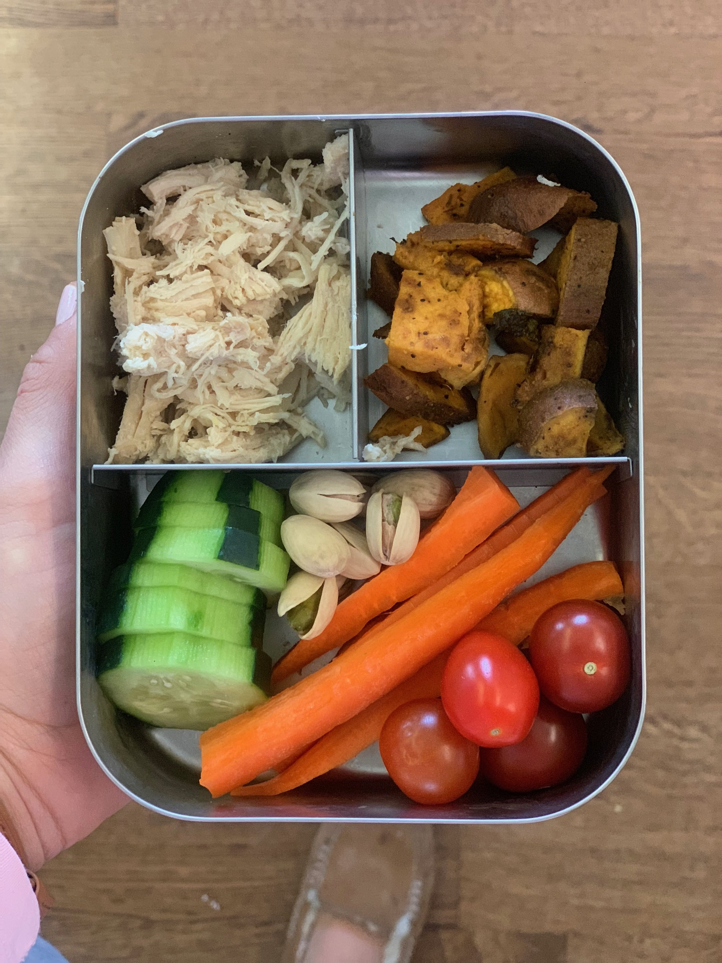 Bottom: Cucumbers, pistachios, carrots, tomatoes  Top left: shredded chicken  Top right: sweet potatoes