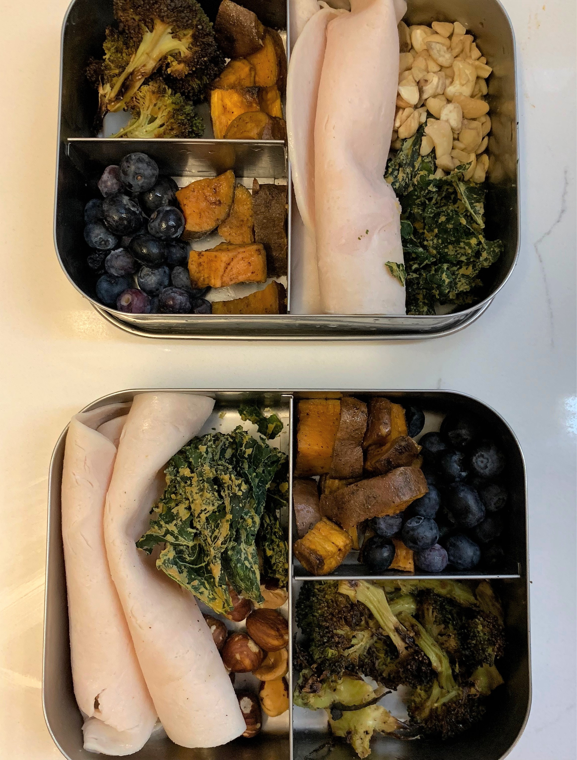 Main: Turkey, nuts (hazelnuts below, cashews above) and vegan kale chips from Trader Joe's  First small section: roasted broccoli  Second small section: Sweet potatoes and blueberries