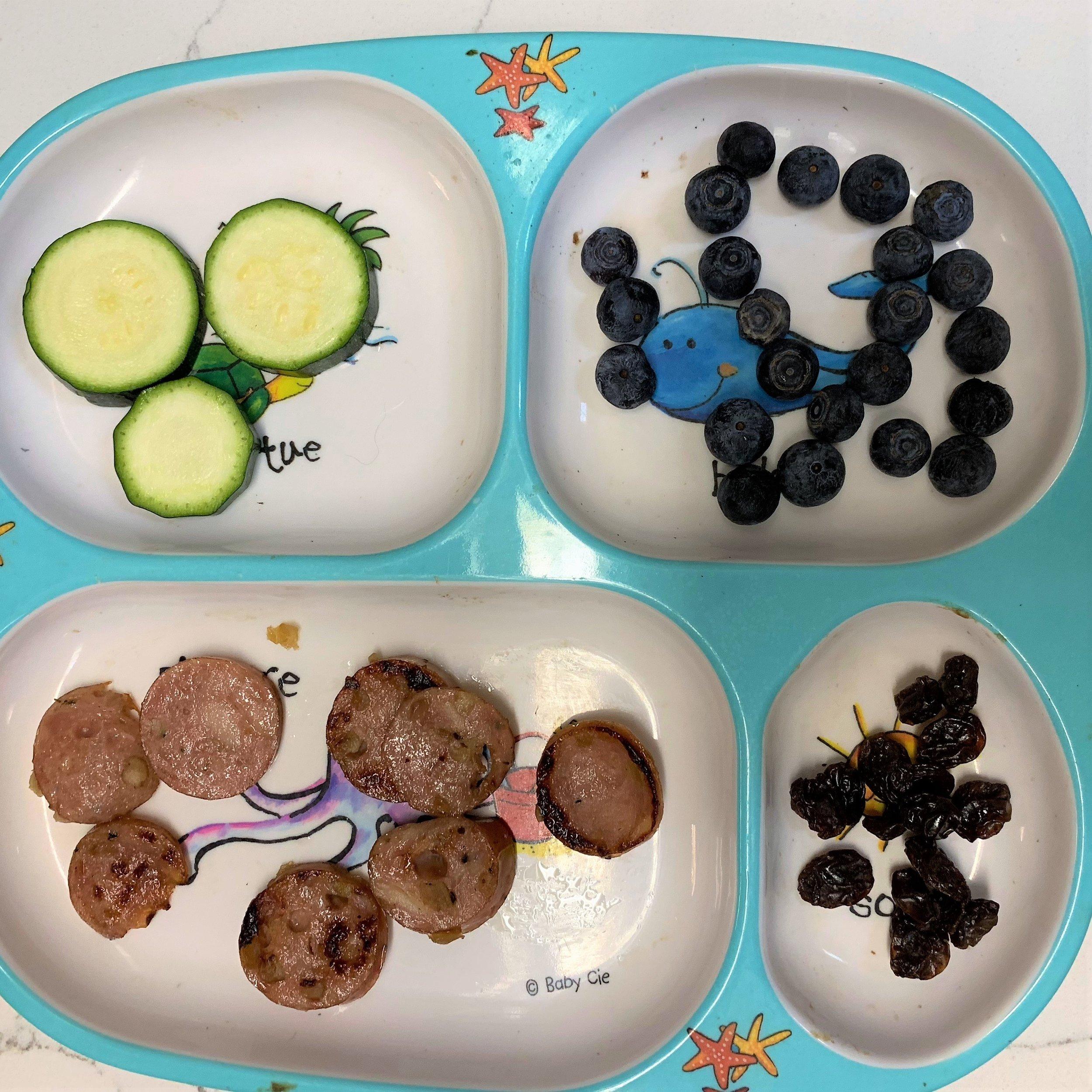 Top left: zucchini   Top right: blueberries  Bottom left: chicken sausage  Bottom right: raisins