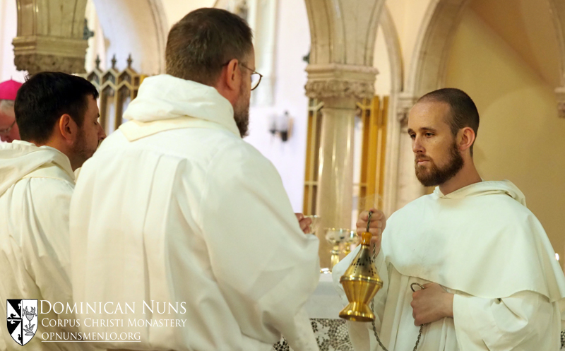 Brother Matthew Heynen, O.P. incenses the two concelebrants, Father Christopher Fadok, O.P. and Father Dennis Klein, O.P.