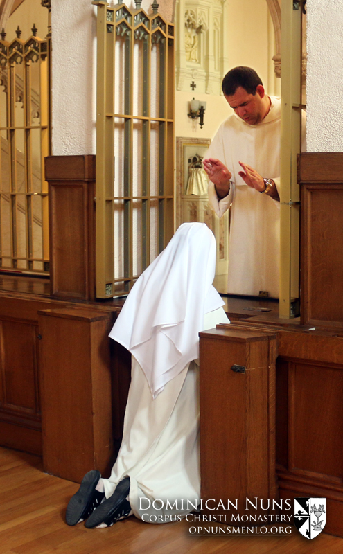 Father Henry Stephan, O.P. of the Eastern Dominican Province gives his blessing to the sisters after his Mass of Thanksgiving.