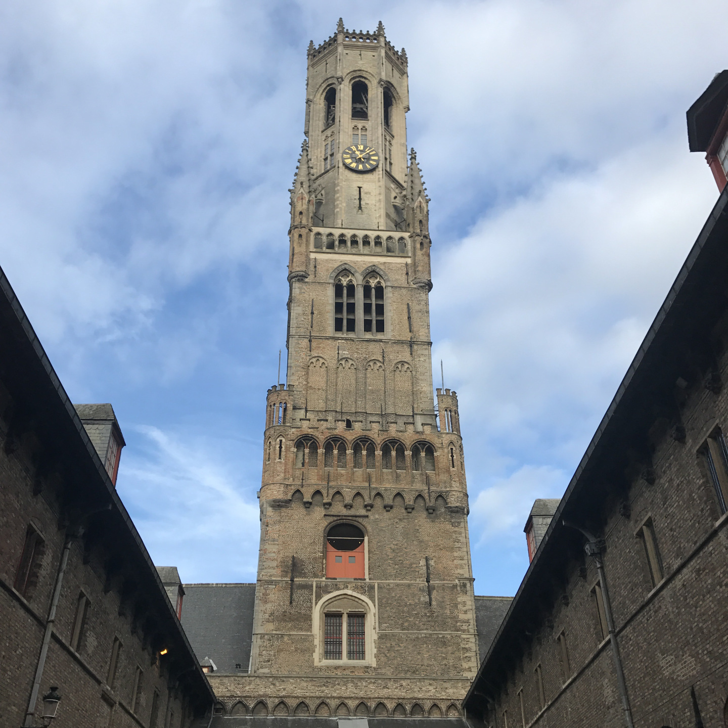 The view of the belfry of Bruges from within the courtyard behind it