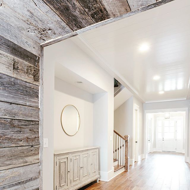 There's always a spot for a little distressed wood. #entryway #transitiondesign #honedesign #exposedwood #distressedwood #classic #franklintn #montgomeryclassic