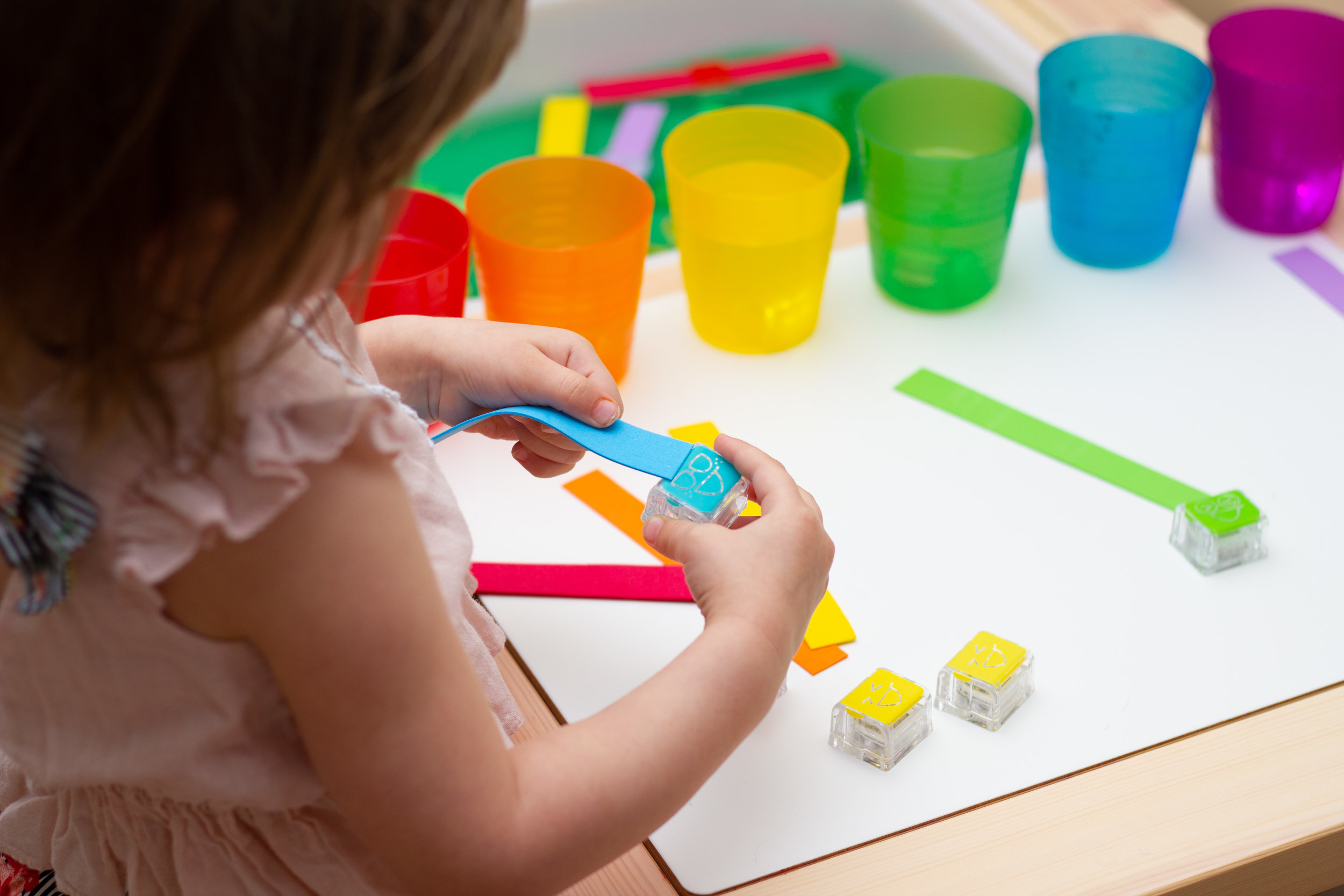 Fine Motor - Threading craft foam through the Glo Pals encourages fine motor and color sorting skills