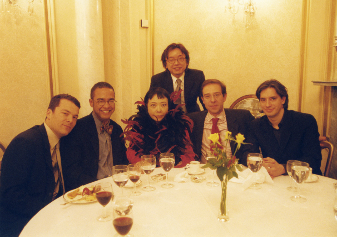 Andrew Kreps, Steve Henry, Yayoi Kusama, Hidenori Ota, Claudio Guenzani, and Christopher D'Amelio at dinner in London at the time of Kusama's exhibition at the Serpentine Gallery in 2000.