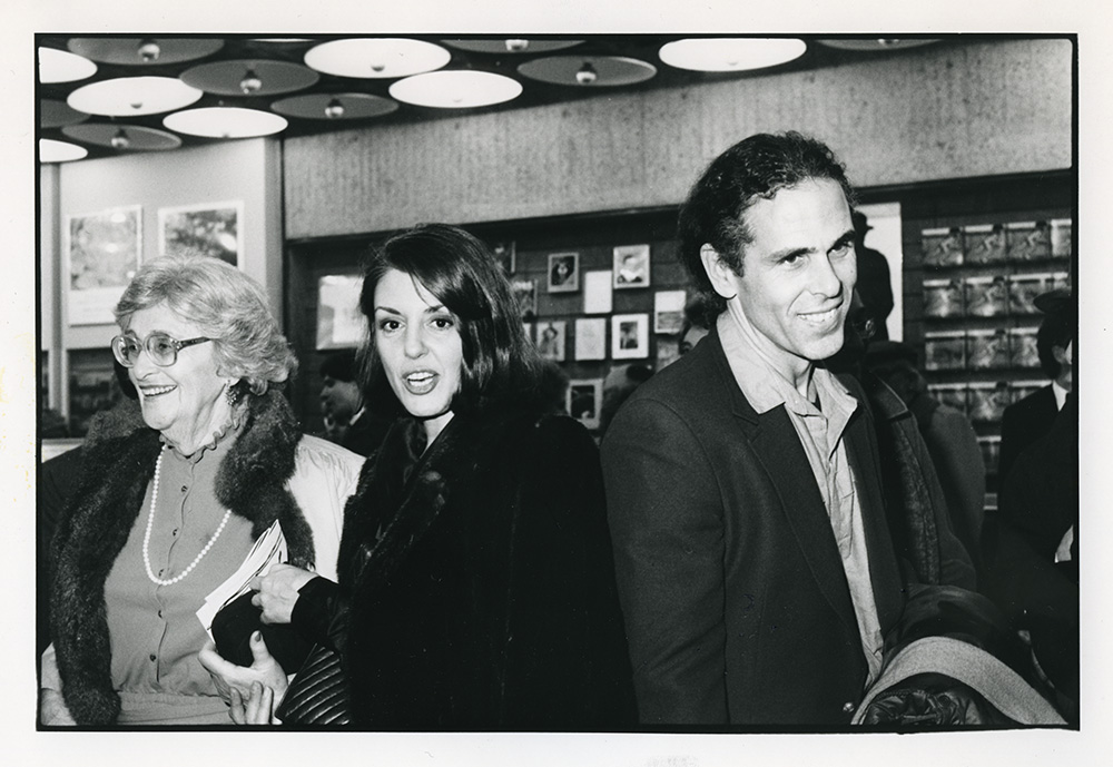 Jonathan Borofsky's mother, Paula Cooper, and Jonathan Borofsky at the opening of his exhibition at the Whitney Museum of American Art, 1984. Photo by George Hirose.