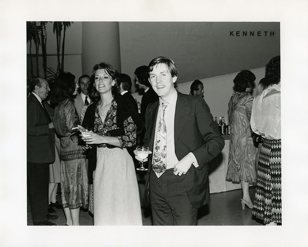 "Paula Cooper and James Mayor at the opening of ""Kenneth Noland: A Retrospective"" at the Solomon R. Guggenheim Museum in 1977. Clement Greenberg also in view (far right)."