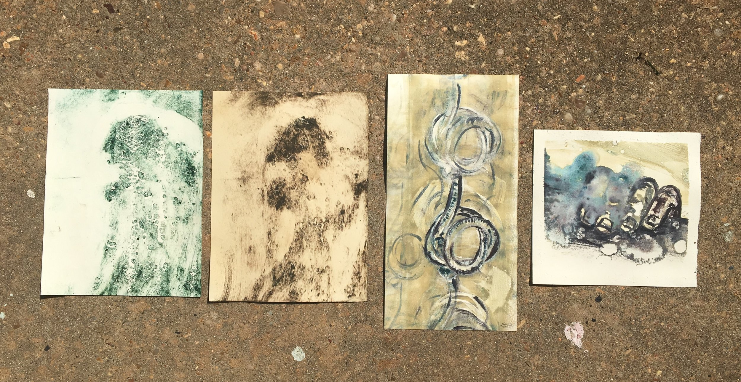 The prints to the left are collagraphs and the ones on the right are monotypes. The collagraph to the far left is an example of more prominent tire marks. I eventually stopped doing collagraphs with the car because in order to get the kind of pressure they required I had to either print really damp or use very few blankets, which both result in tire marks.