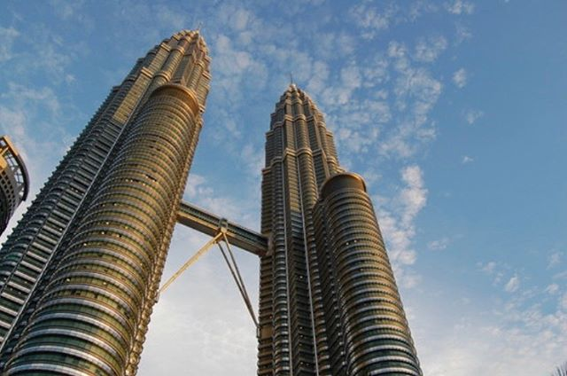 """#WorldWednesday   R.I.P   César Pelli 1926 - 2019   Petronas Towers   Kuala Lumpar, Malaysia   1996  Today's post is in honor of world renown architect César Pelli. We take this time to remember some of his achievements including the Petronas """"Twin"""" Towers which stood as the world's tallest buildings until 2004. Some of his other recognizable additions to city skylines include the Torre de Cristal in Madrid, the World Financial Center in New York, and the Salesforce Tower in San Francisco among many more. """"Cities are our most important responsibility. They are the whole of which our buildings are the parts. Making a building one with its place has been a constant goal of architecture throughout the ages."""" -Pelli  Words/ Images from archdaily.com"""