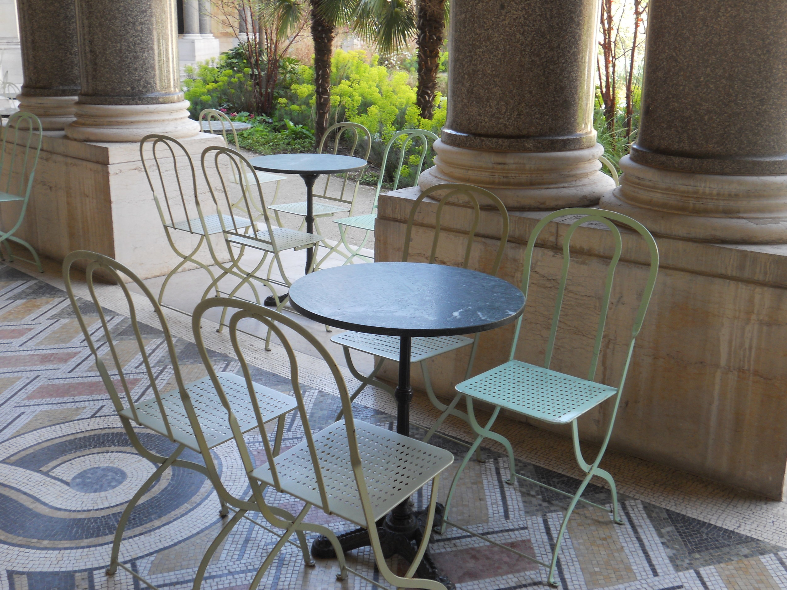 Bistro seating outside museum cafe overlooks garden