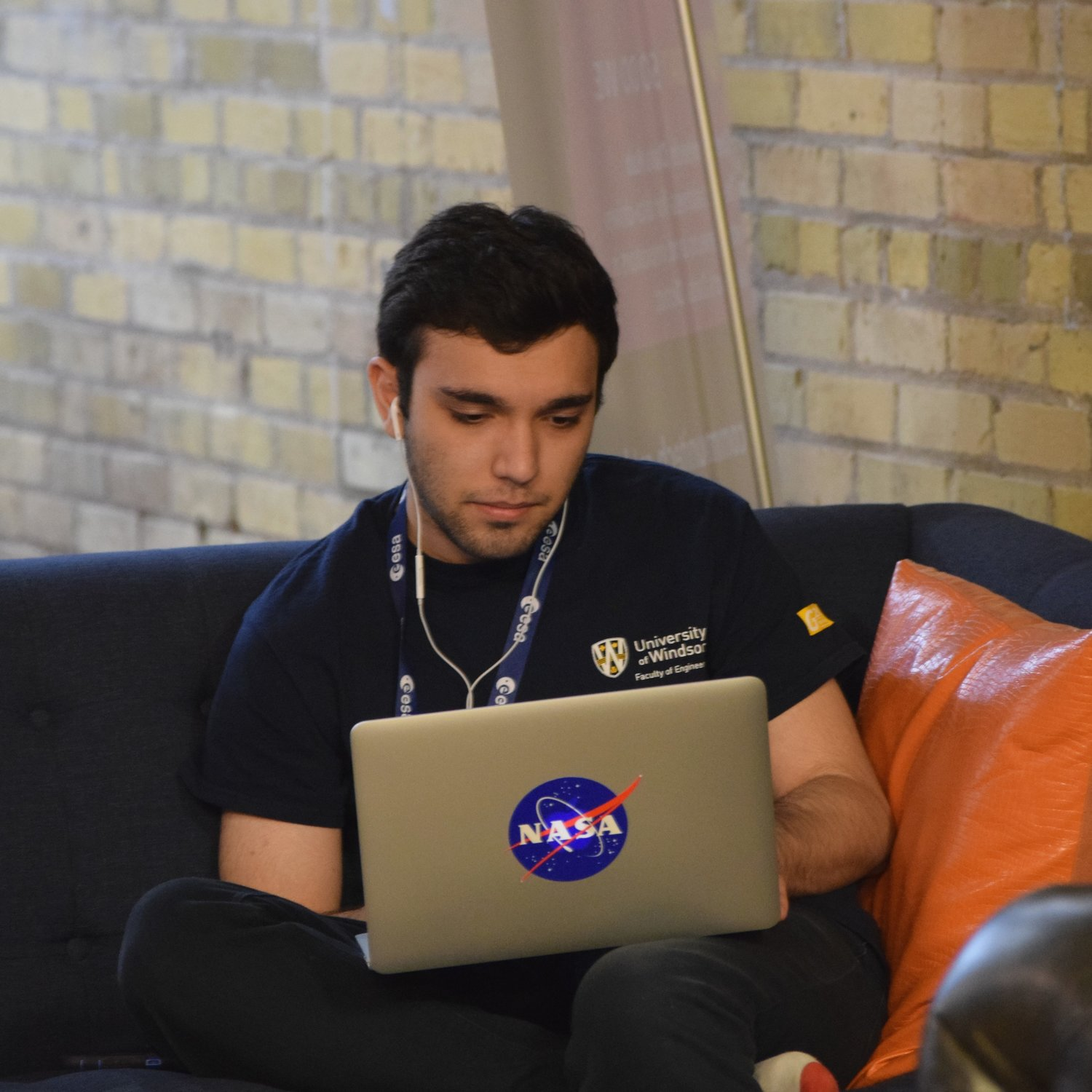 2017 NASA Space Apps participant typing on his computer in the Kitchener Communitech space.