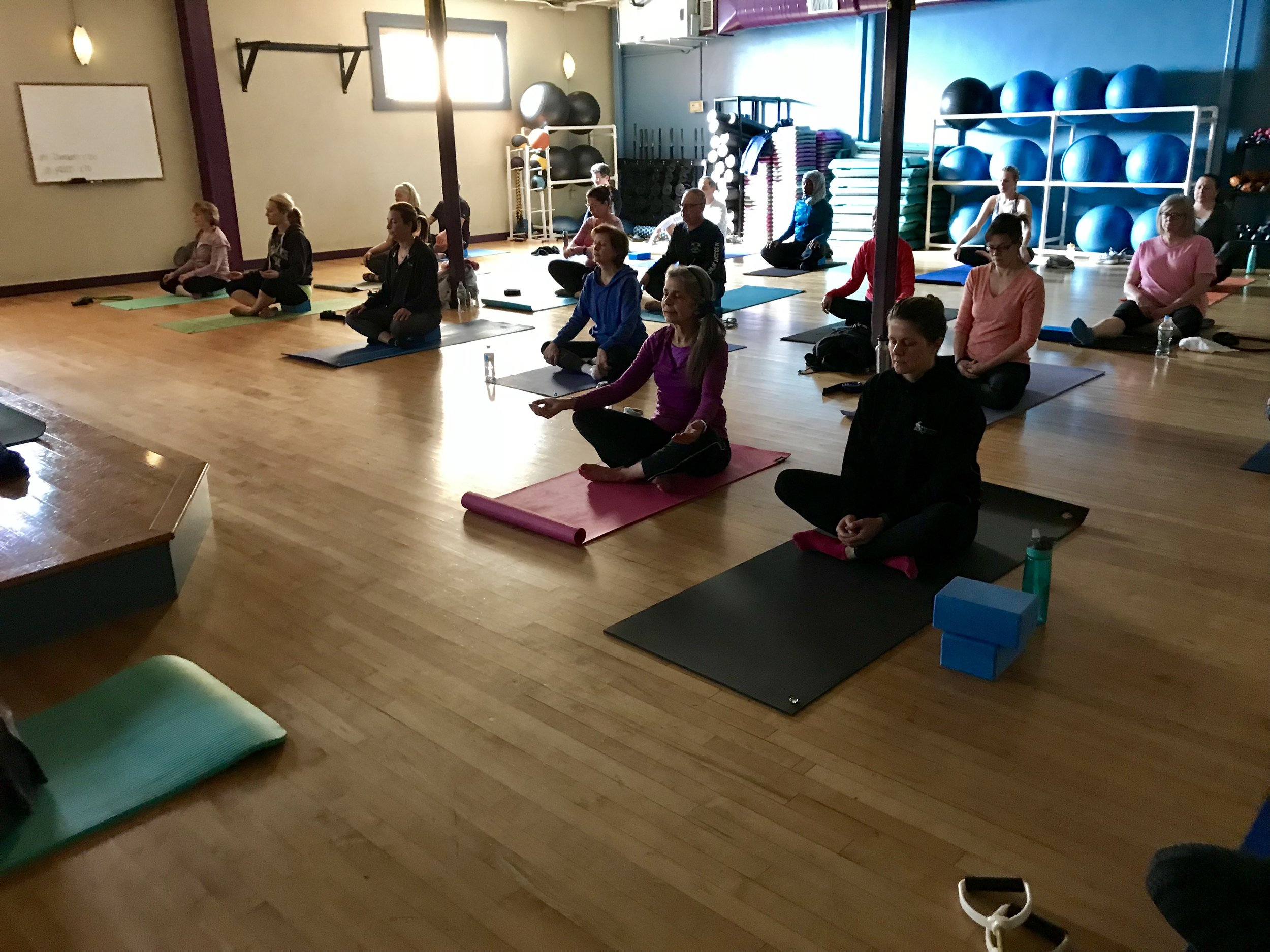 Finding a comfortable seat for each student's body to breathe in this moment and breathe out the rest of the day at the start of one of Daniella's slow flow classes.
