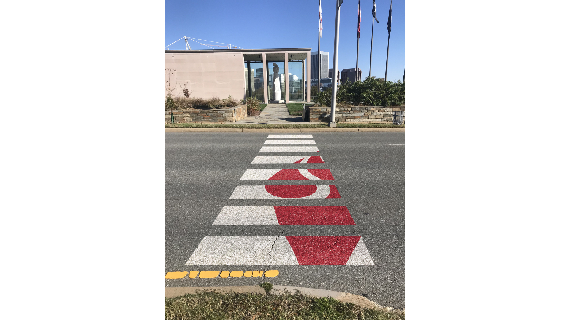 Branded Crosswalk - We recommended adding a branded crosswalk to the very busy intersection in front of the memorial. This was a low-cost execution that promotes pedestrian safety and would be a creative way to put the new Virginia War Memorial & Museum branding on display.