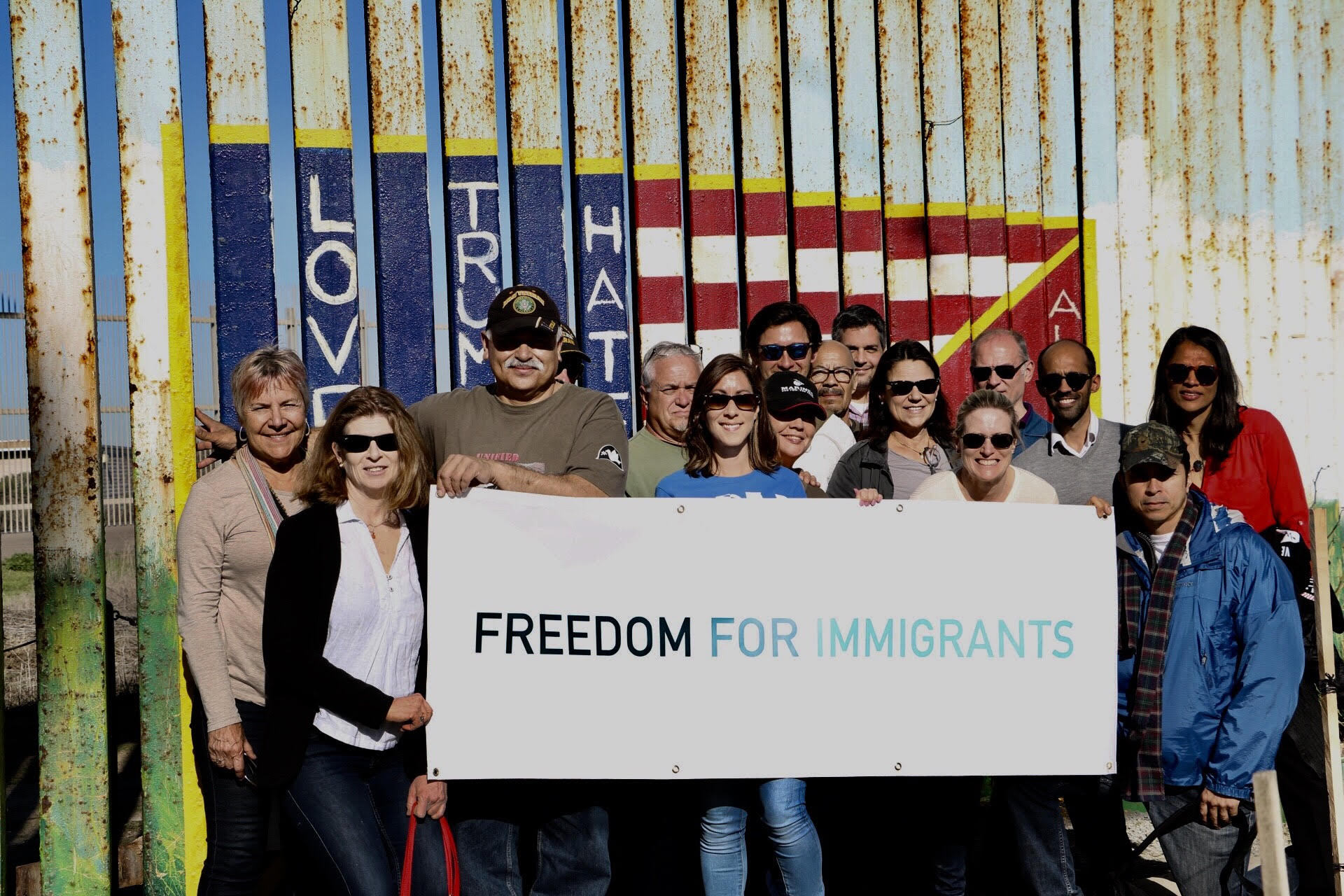 Freedom for Immigrants In Front Of Wall.jpg