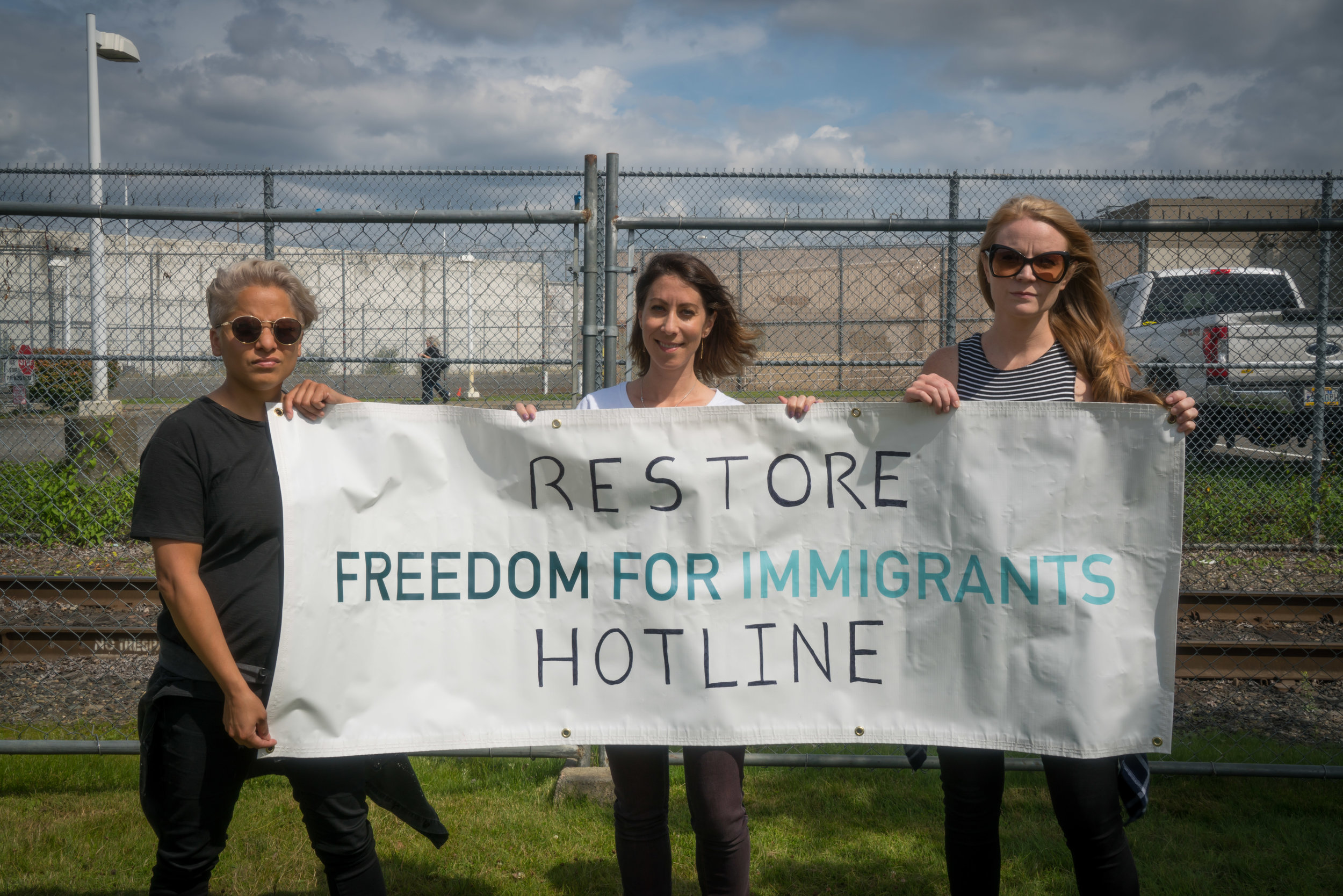 Orange Is The New Black  actors Vicci Martinez (left) and Emily Tarver (right) join Freedom for Immigrants' co-founder Christina Fialho outside the Northwest Detention Facility in Washington.