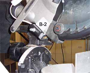 """1. The arm that moves the plastic blade guard should be removed and straightened.  2. A 1/2"""" spacer needs to be added between the guard arm and threaded hole. A longer bolt is needed to replace the original bolt.  3. Attach the B-2 bracket to the left side and the back of the blade guard just above the rubber dust collector.  4. Re-install guard arm.  5. Position the Laserkerf at the top of the rubber guard. Align per installation instructions."""