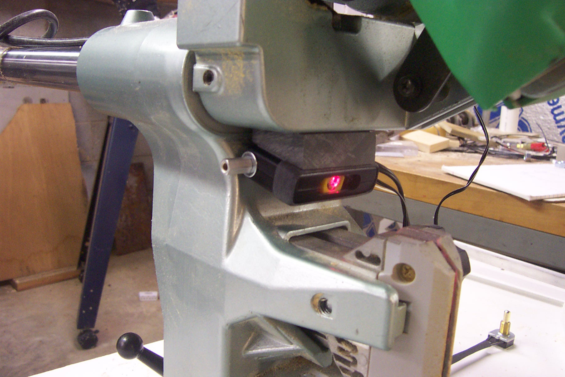 8. The following pictures are to assist you in positioning the laser in direct line with the blade per the installation instructions.