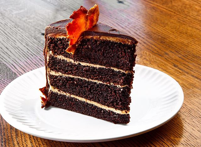 Dance with the devil tonight with a slice of our Vice Cake! Everything you hate to love: chocolate ganache, stout chocolate cake, coffee buttercream, candied bacon... Don't worry, there's plenty of time to repent afterwards before Sunday. #sinful #vice city #chocolatestacksonstacks #cakegamestrong #idaclaire #southofordinary