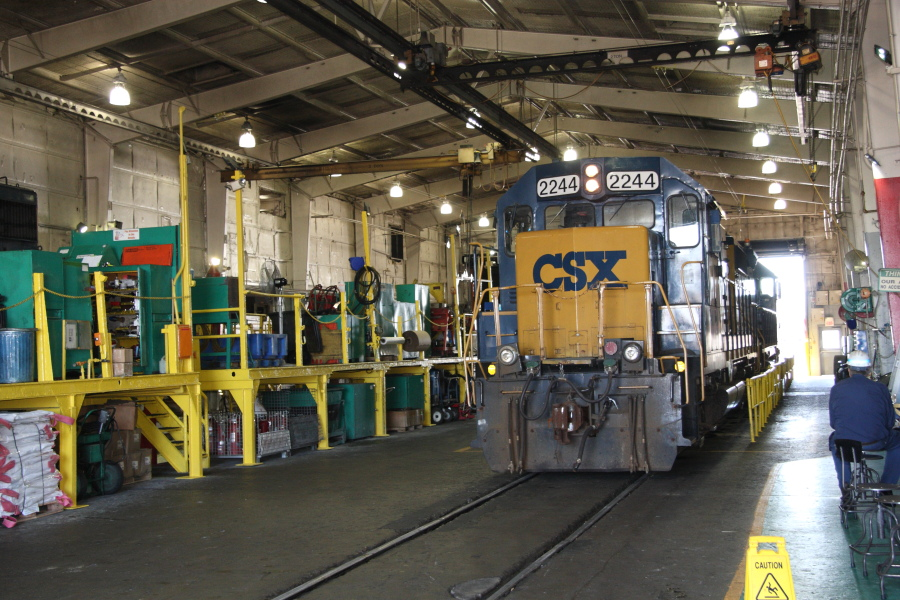 A pair of engines move through the locomotive shop building at CSX's Avon Yard