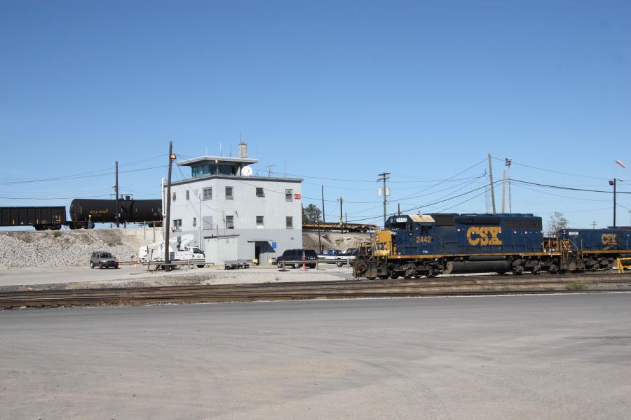 An SD40-2 and slug set passes the Avon Yard hump tower