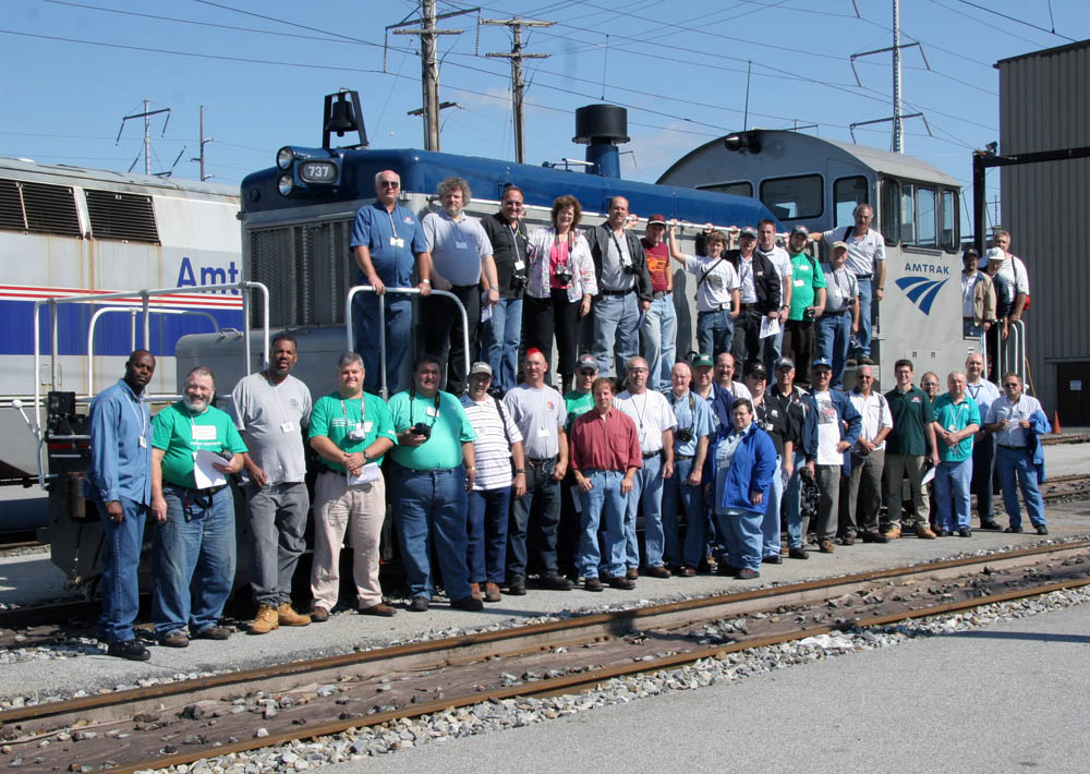 Group photo with Amtrak SW1 737, built as NYC 703