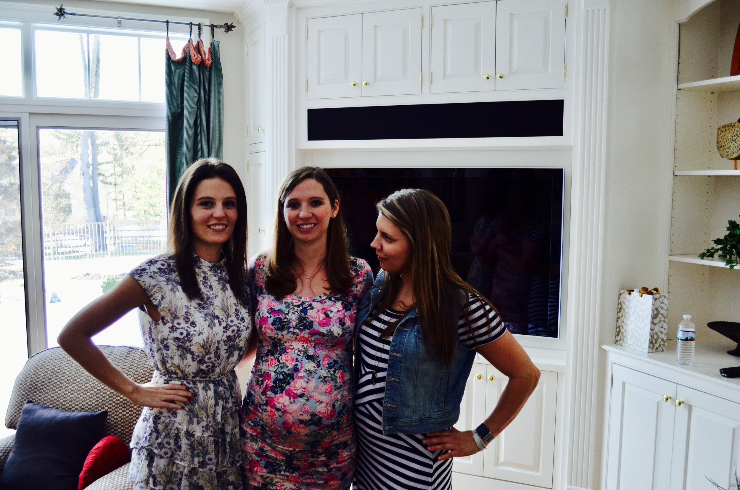 Here we are for my sister's baby shower! I am on the left wearing a floral dress from Elan.