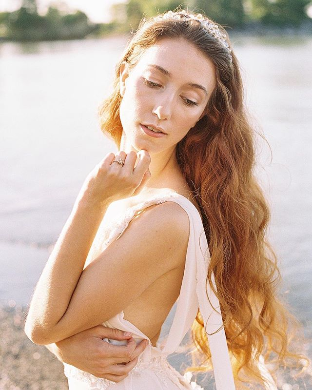 Daria captured on 35mm #Portra400 💛  at sunrise this past summer.. I just love the golden and orange tones :)... gown by @winsdesign  Hair piece @morganlovely  Hair @xristinakolovos  Makeup @thelookbridal  Ring @meglizabet  Planning @juniper.event.co . . . . . . .  #weddingphotographer #weddingphotographers #filmisnotdead #stylemepretty #fineartphotographer #weddinginspo #engagementphotographer #soloverly #huffpostido #destinationweddingphotographer  #torontoweddingphotographer #torontofilmphotographer #chicagoweddingphotographer #chicagoweddingphotography #fineartphotography #weddinginspiration #smpweddings #ishootfilm #filmphotography #portra400 #chicagoengagementphotographer #engagementphotography #35mmfilm #torontoengagementphotographer #canadianweddingphotographer #ontarioweddingphotographer #filmshooter #chicagoengagement #torontoengagement