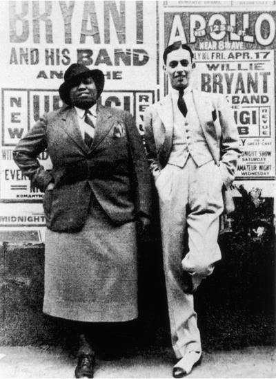 Bentley and bandleader Willie Bryant, April 17, 1936, in front of posters for their Apollo show ( source )