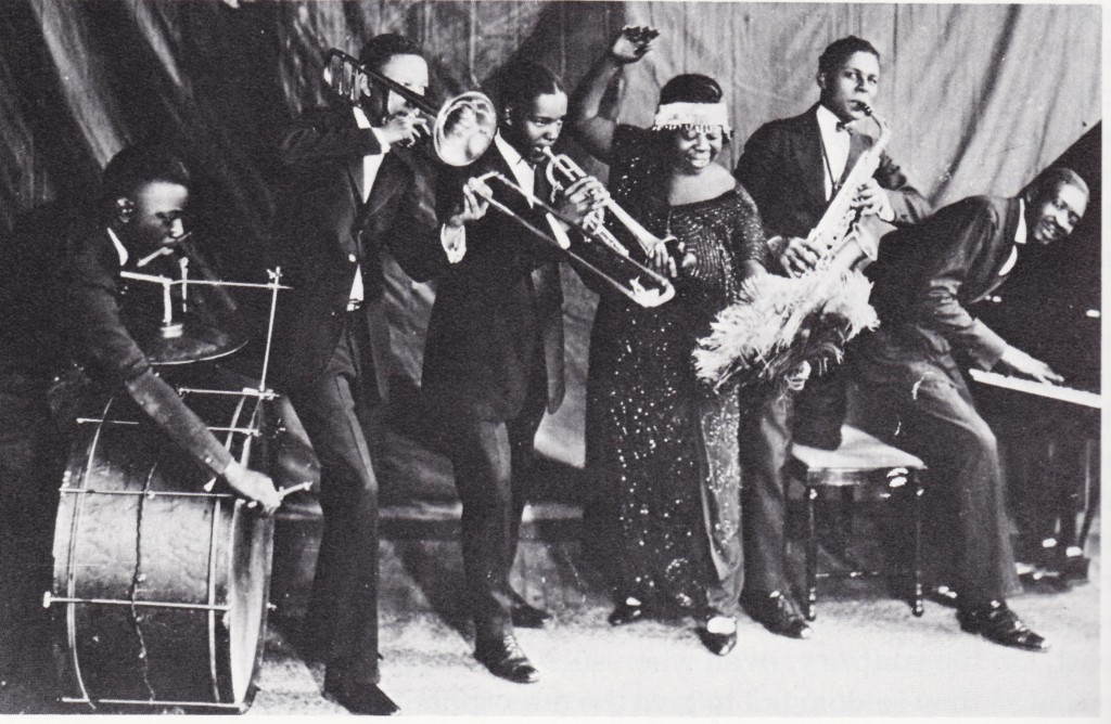 Ma Rainey and her wildcats jazz band, featuring Thomas Dorsey on Piano. ( source )