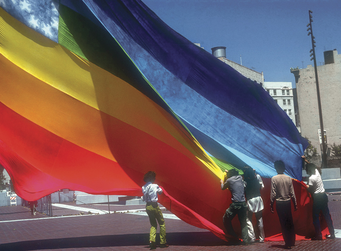 Gilbert (in the vest) and collaborators raising the first flag in 1978 (© gilbertbaker.com)
