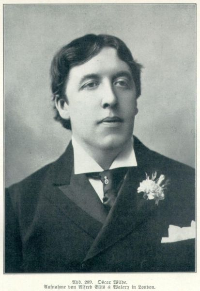 Oscar Wilde with a carnation in his buttonhole. Portrait by Alfred Ellis & Walery Studio, 1892.