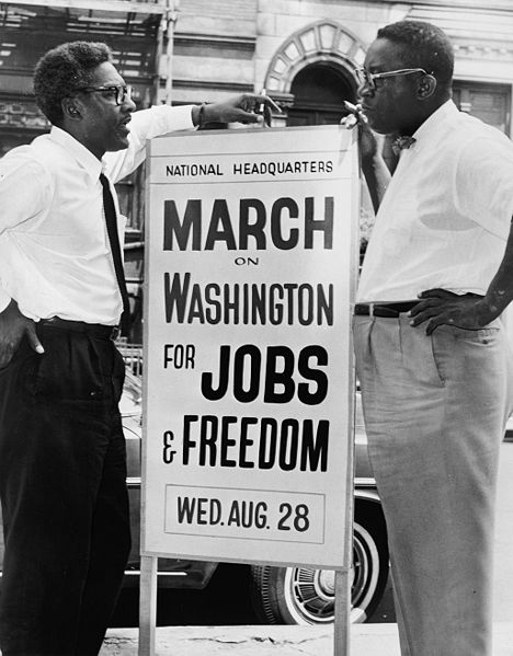 Bayard Rustin and Cleveland Robinson with a sign advertising the march on washington, 1963.