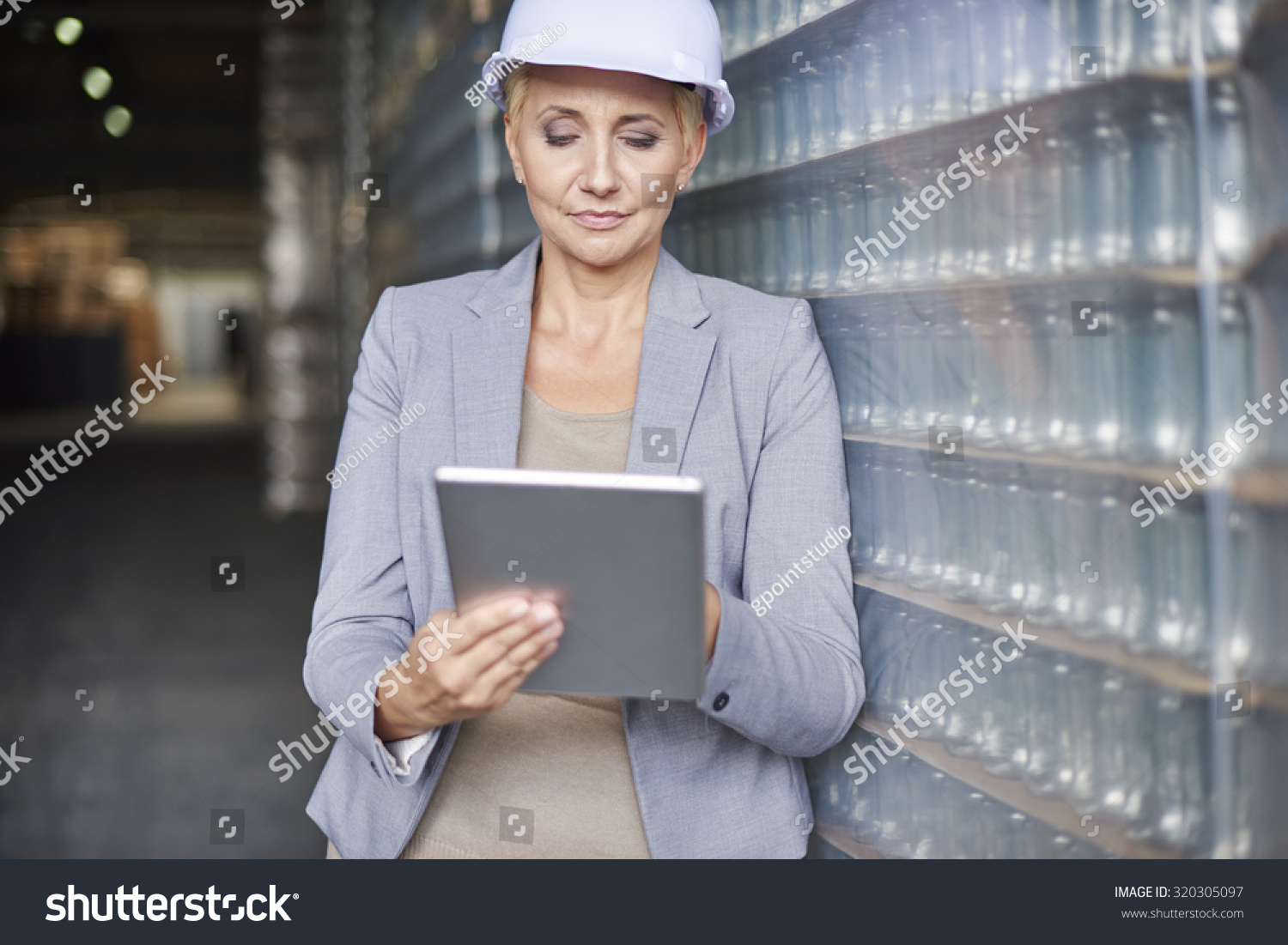 stock-photo-checking-the-new-software-for-delivery-of-merchandise-320305097.jpg