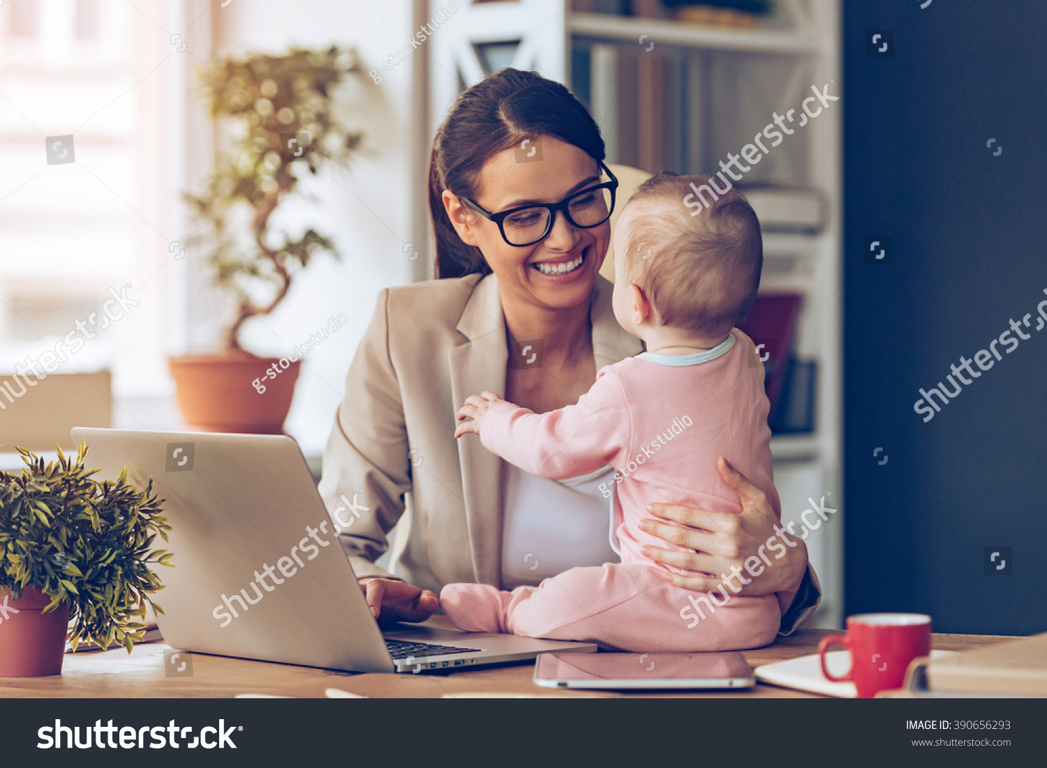 stock-photo-working-together-is-so-fun-cheerful-young-beautiful-businesswoman-looking-at-her-baby-girl-with-390656293.jpg
