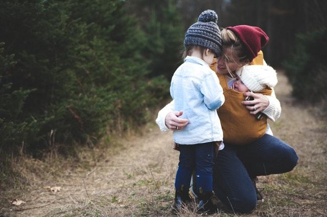 pexels pic woman holding baby hugging kid.jpg
